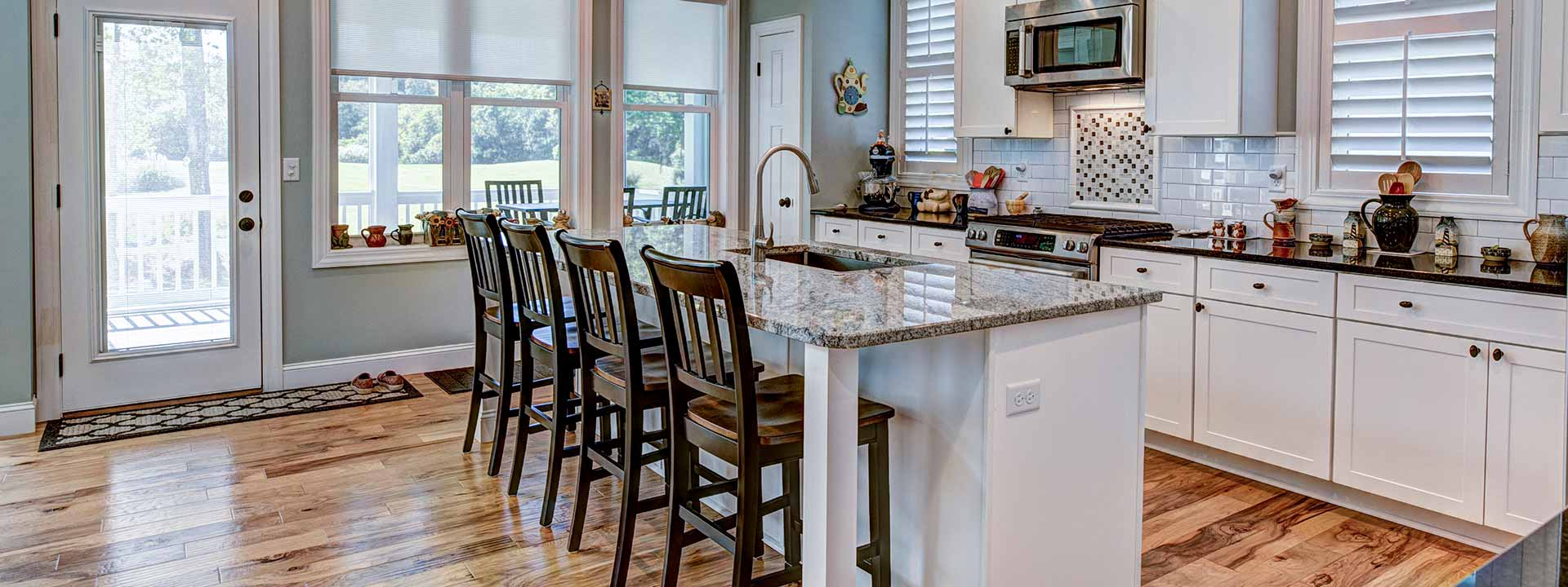 modern kitchen with island counter top and chairs